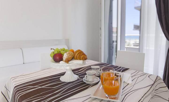 Hotel a rivabella ingressi sconti scivoli arenas parco for Nuove case con suite suocera